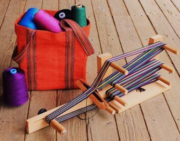 Inkle weaving belts and straps on simple loom in Linda Hartshorn's workshop